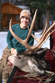 Spencer Carson, 16 with buck