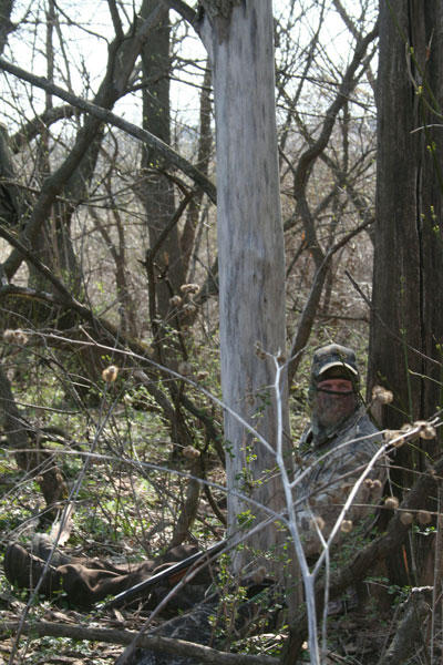 photo of camoflauged Dick Ellis is wooded area